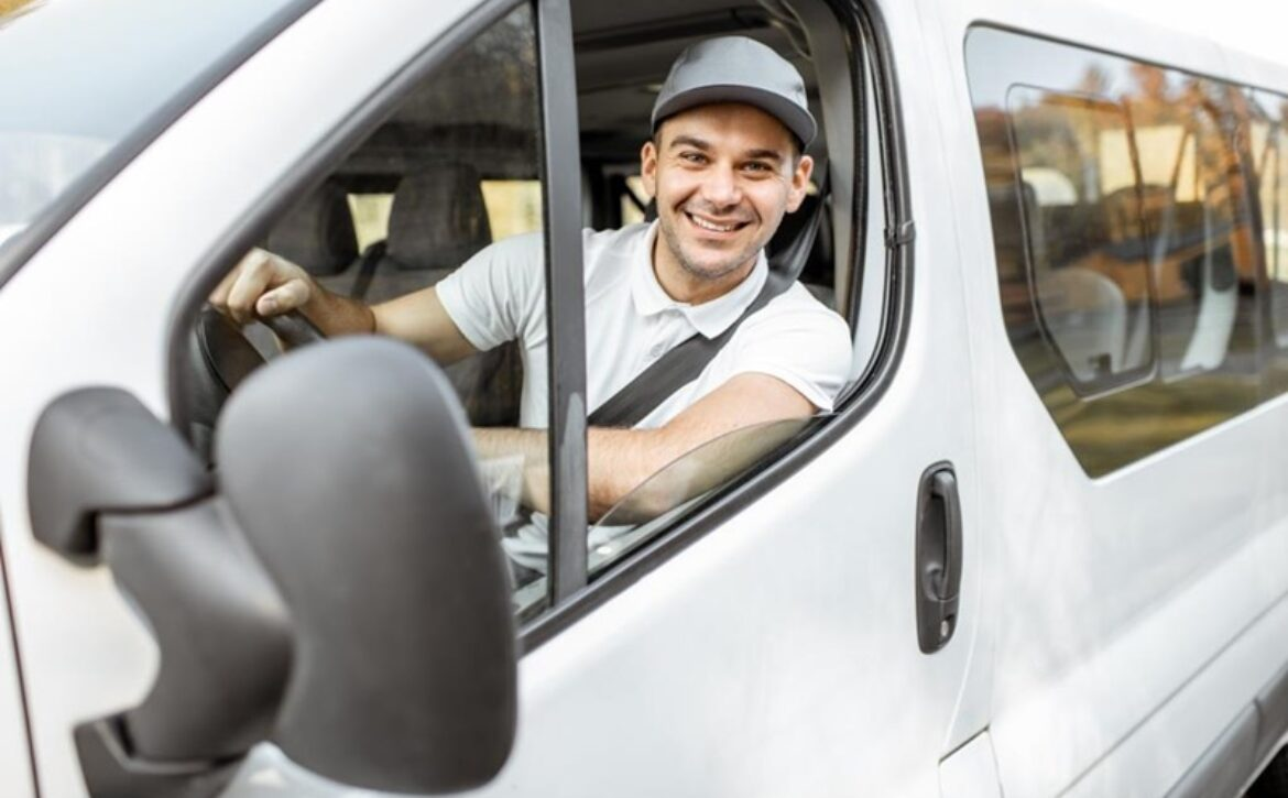 Portrait of delivery driver in the car